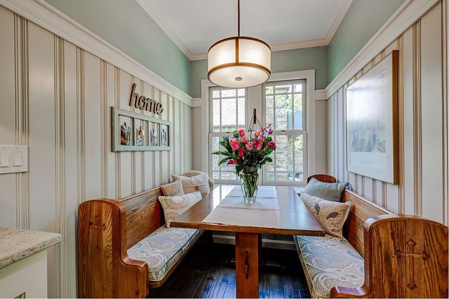 White coupled with wood and pastel green in the small dining room