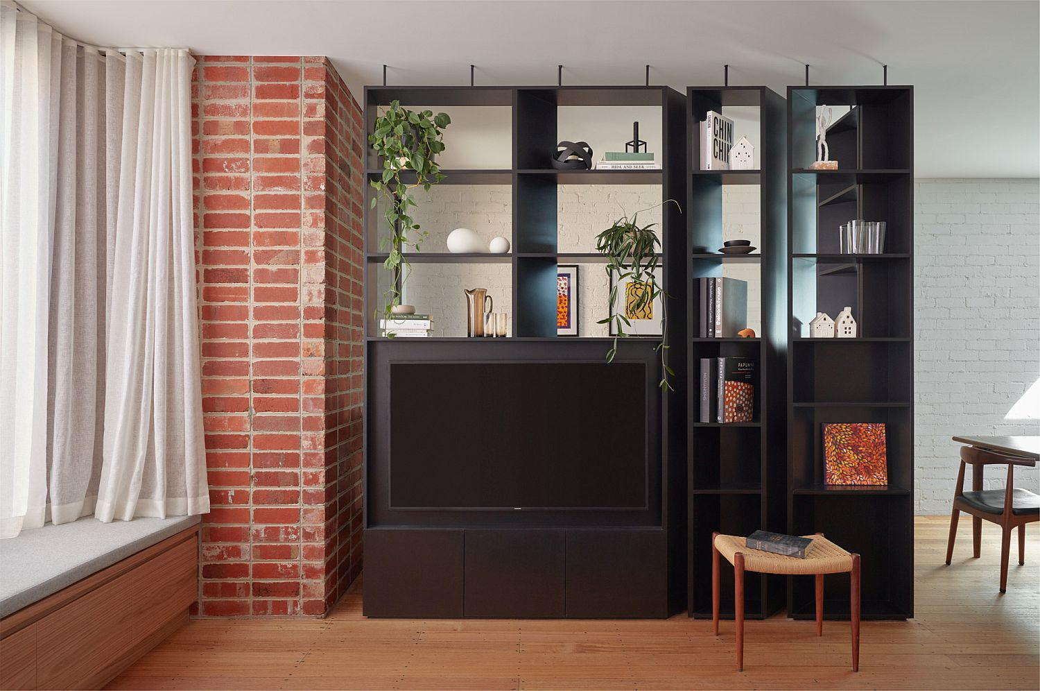 Custom black TV unit and shelving for the living space