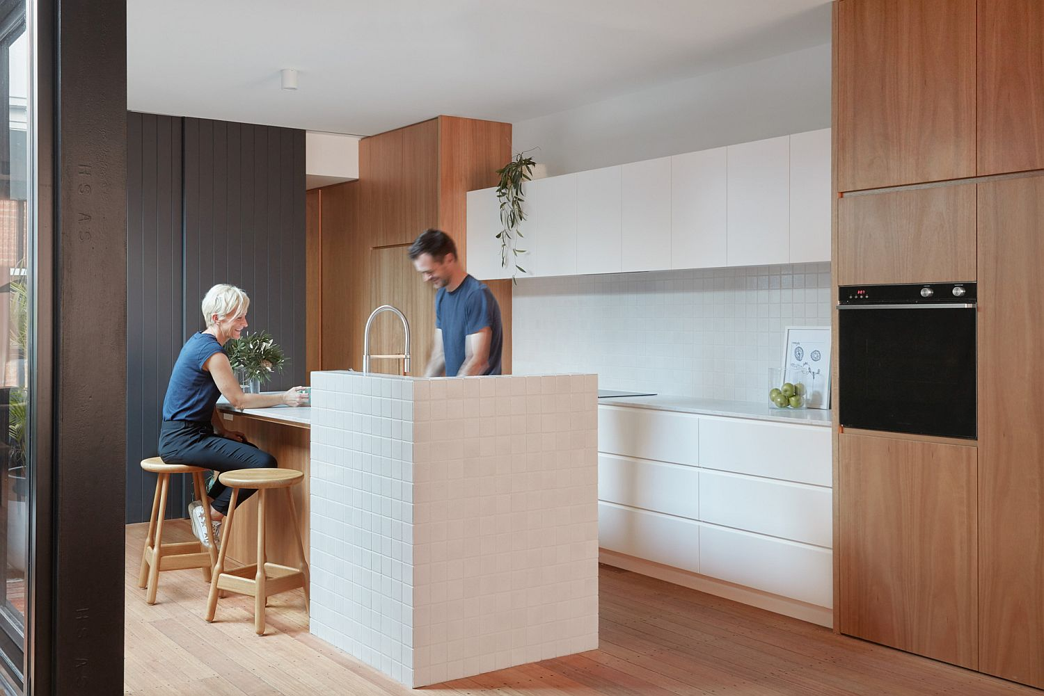 Gray white and wood kitchen of the Melbourne home