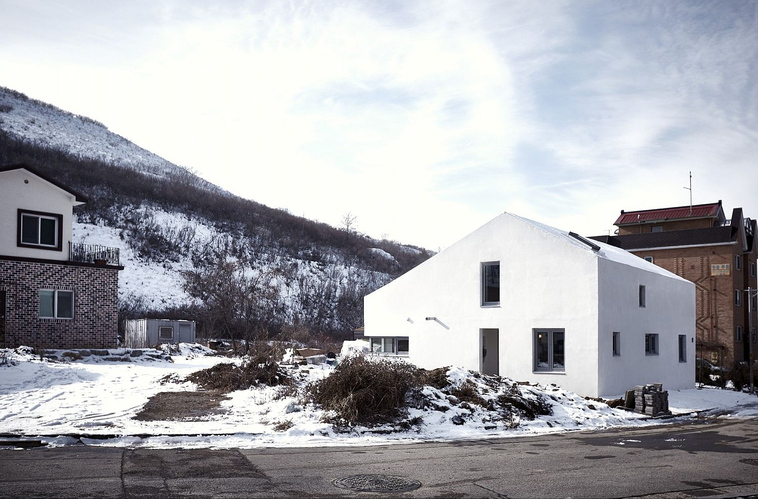 Snow-clad landscape around the contemporary home
