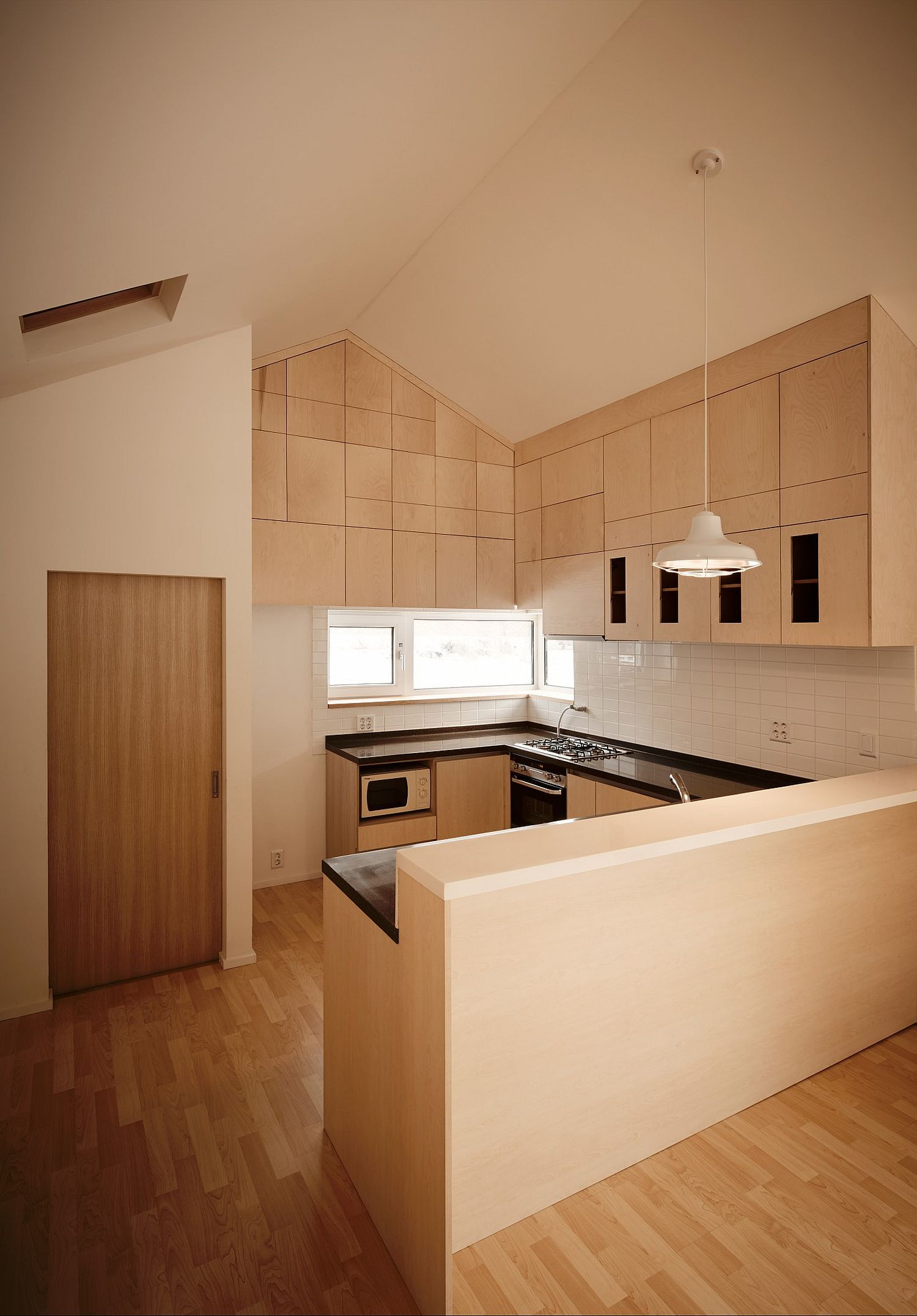 Wooden kitchen and interior of the budget South Korean home