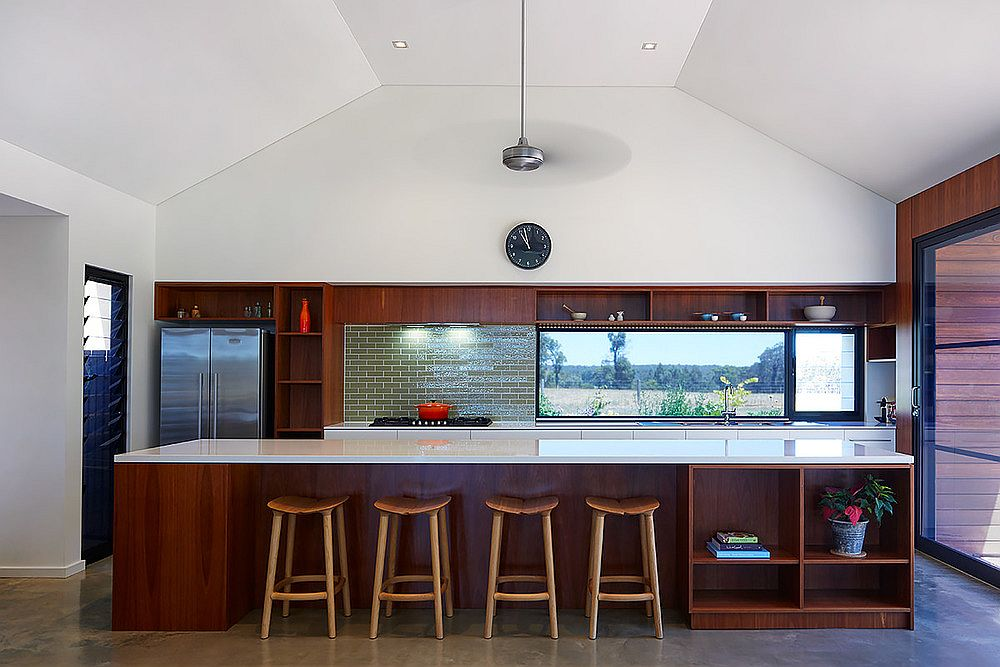 Kitchen with wooden island and a lovely green tiled backsplash