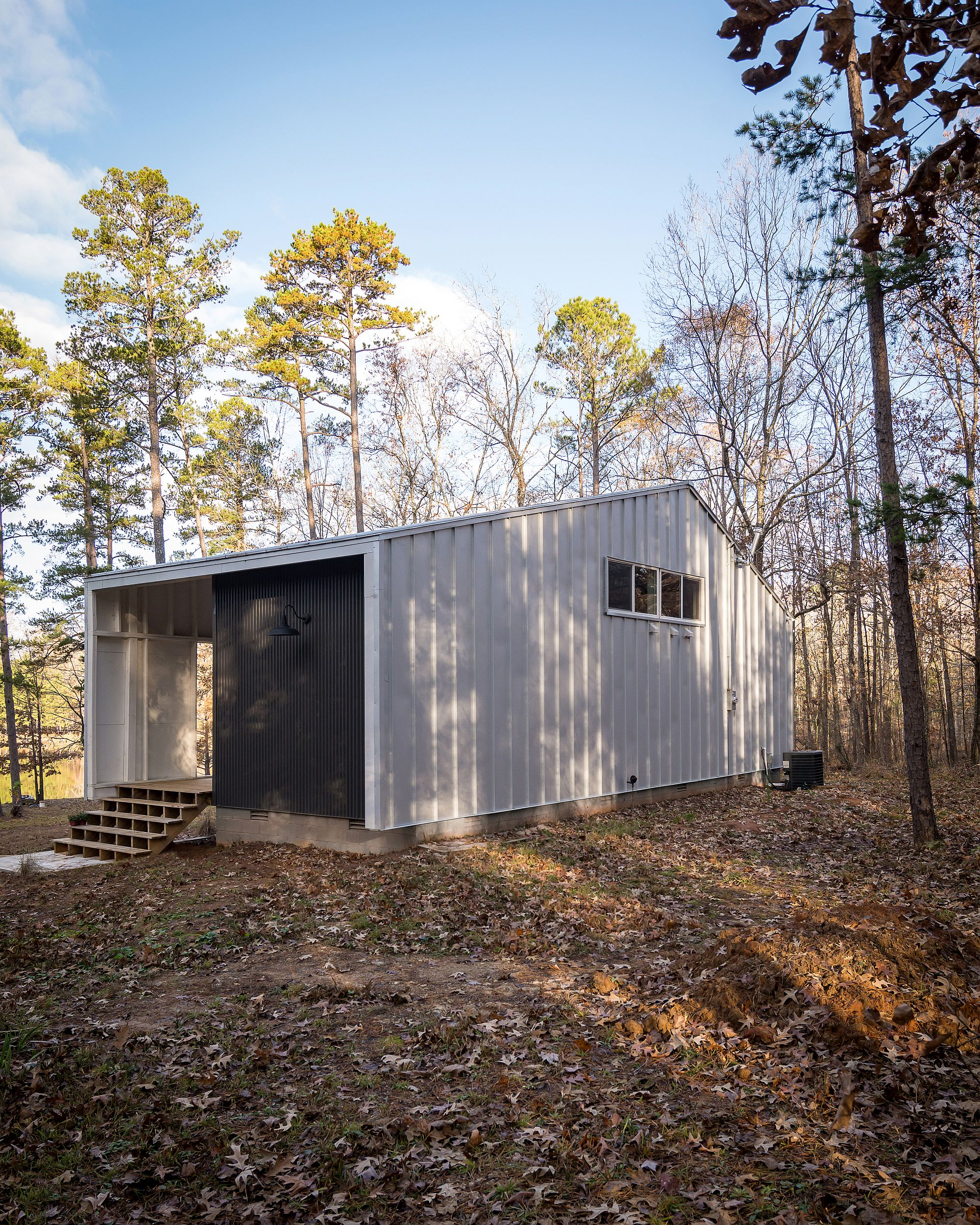 Metal panels create a cool cabin in the woods