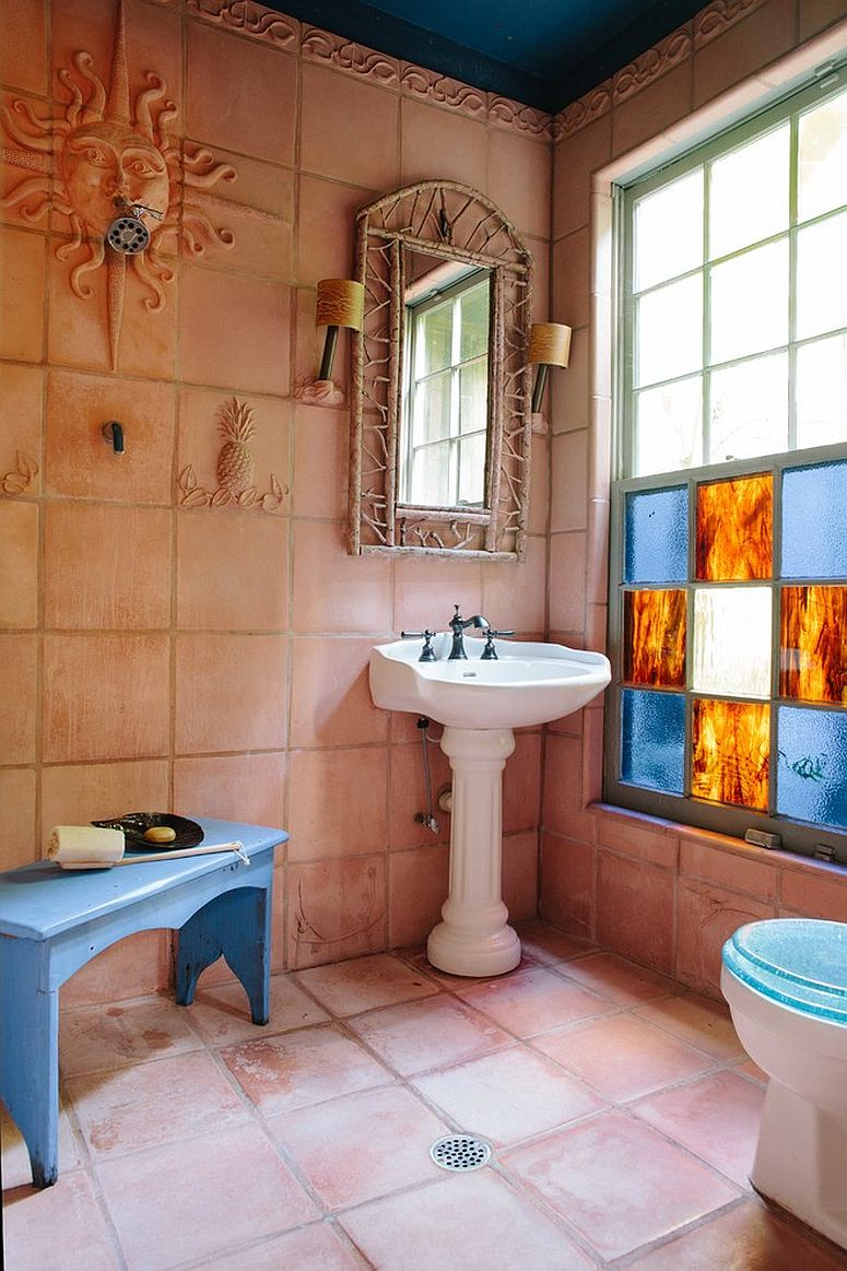 Rustic bathroom with Mediterranean appeal and gorgeous use of terracotta tiles