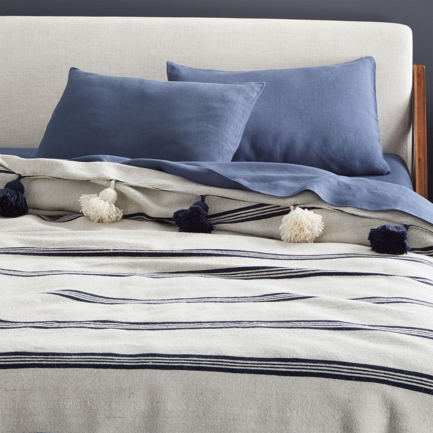 Tasseled blanket with stripes