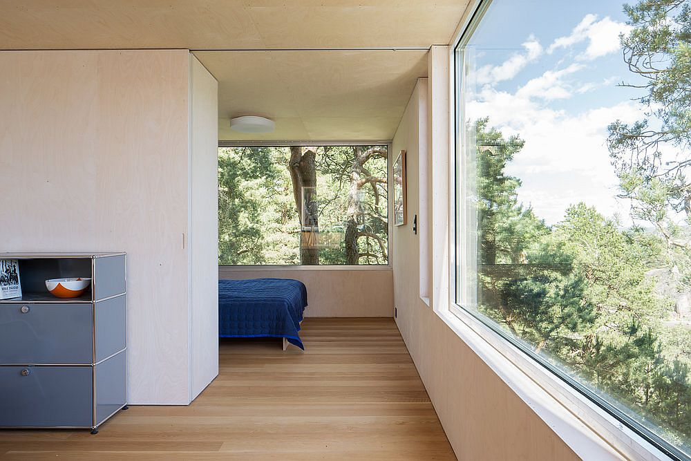 Spacious and light-filled bedroom of the cottage with brilliant views of the islets