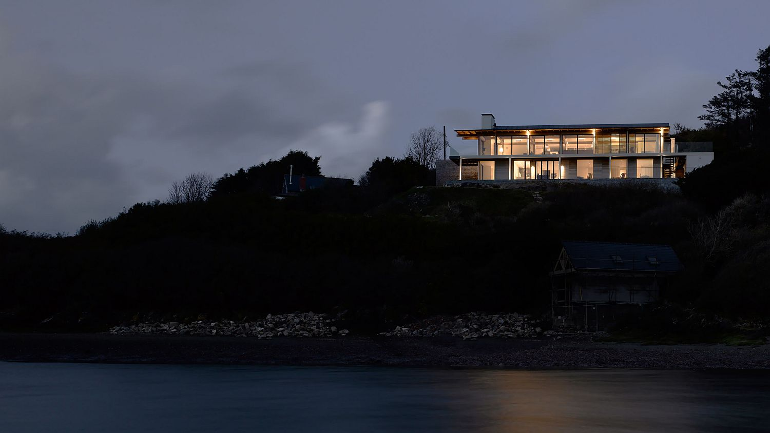 View of the Trewarren House after sunset
