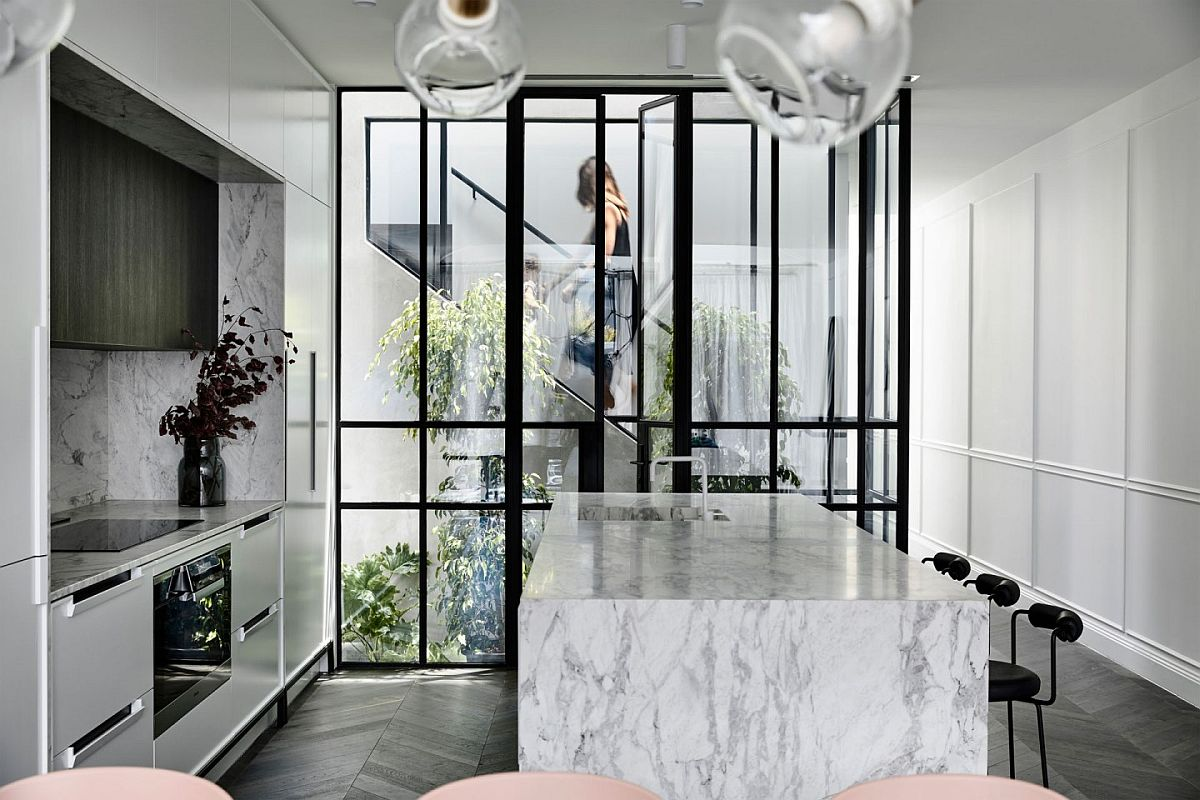 Lovely little atrium brings greenery to the kitchen and living area