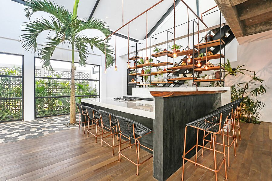 Brilliant use of Edison bulb lighting in the modern tropical style kitchen