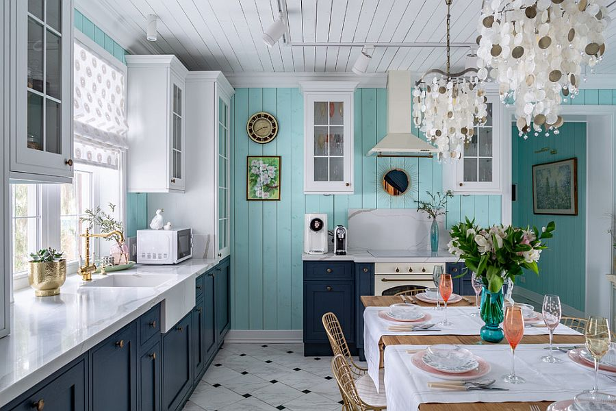 Combing blue, white and gray in the beach style kitchen and dining space with ease