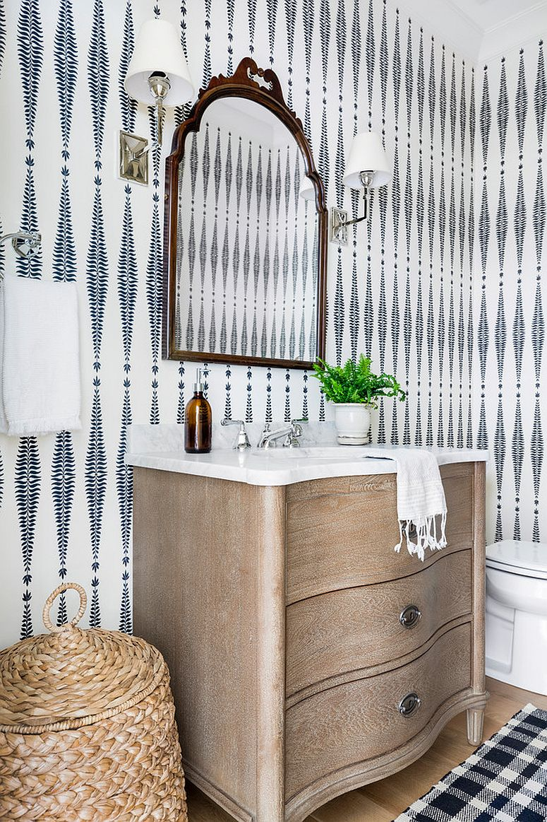 Accessories, wallpaper and lighting give this powder room a cool look