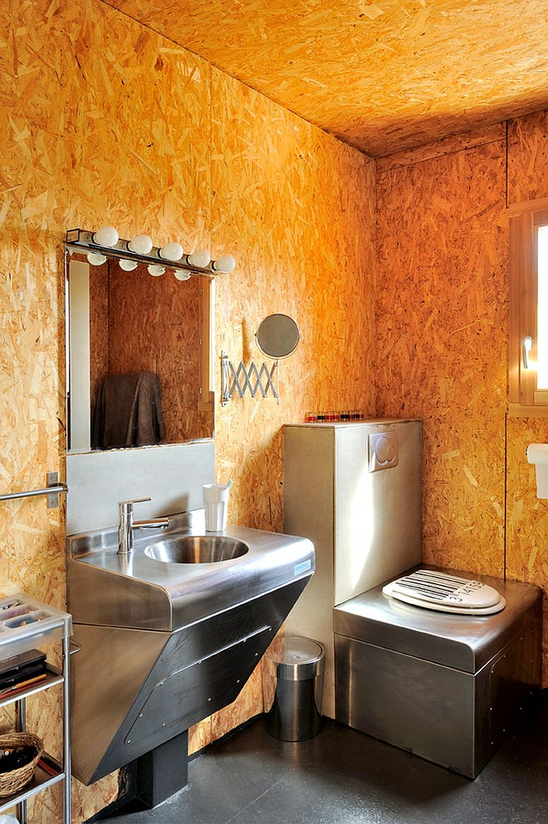 Awesome textured bathroom walls bring orange glow to the setting