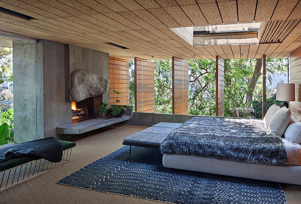 Ceiling and concrete walls give the modern bedroom a different visual appeal