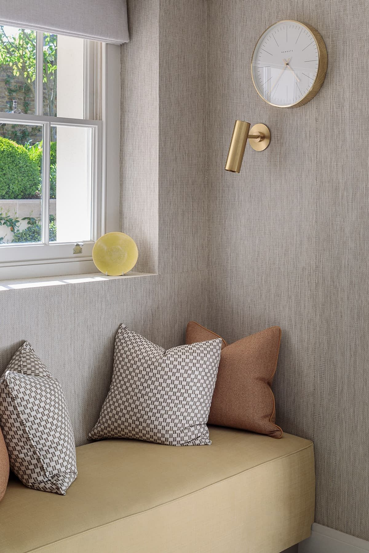 Comfy window seat with lighting that feels cozy