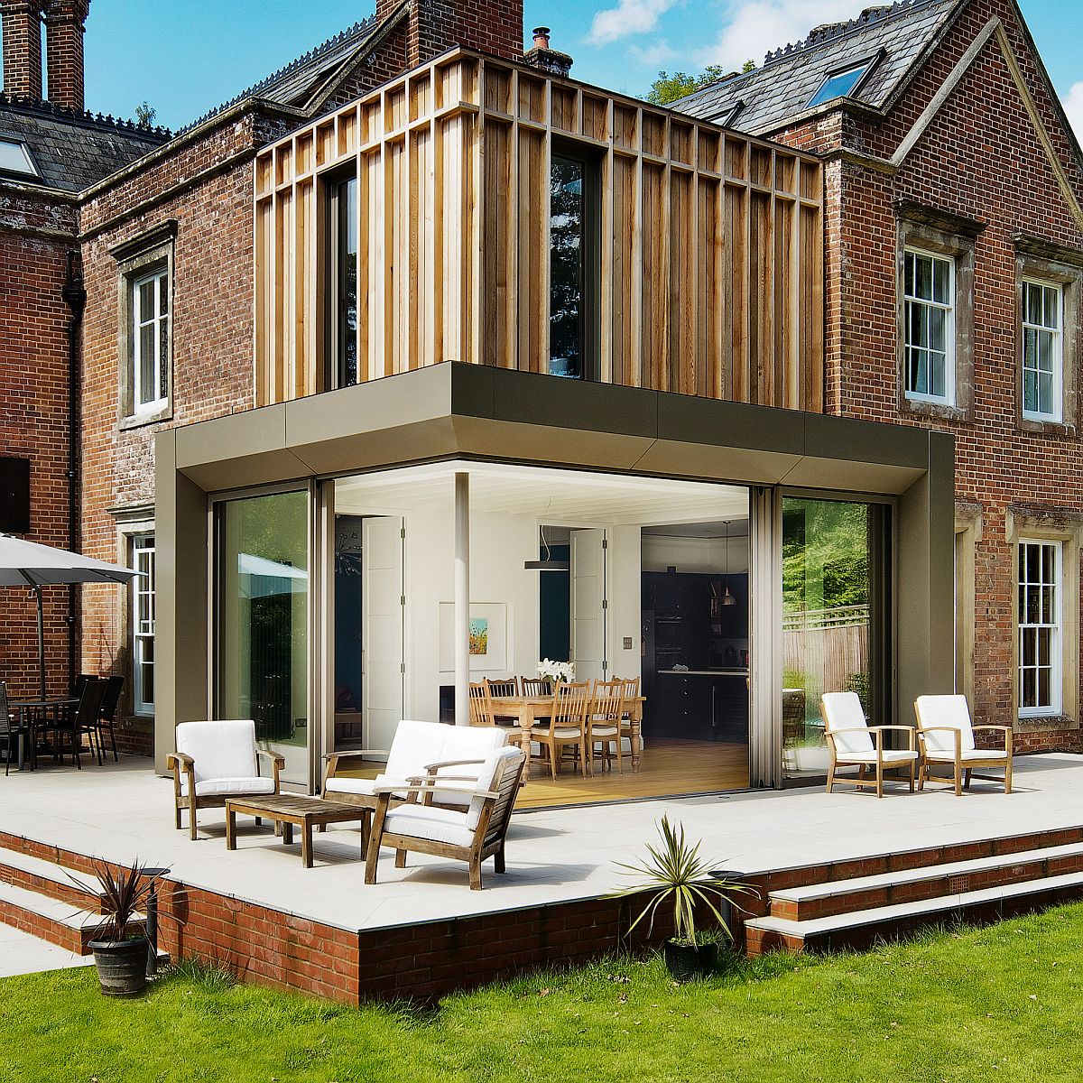 Delightful contemporary extension to historical family house with brick exterior