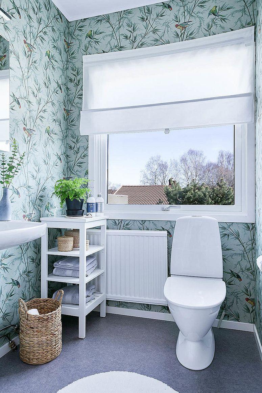 Delightful wallpaper for the light-filled Scandinavian style powder room