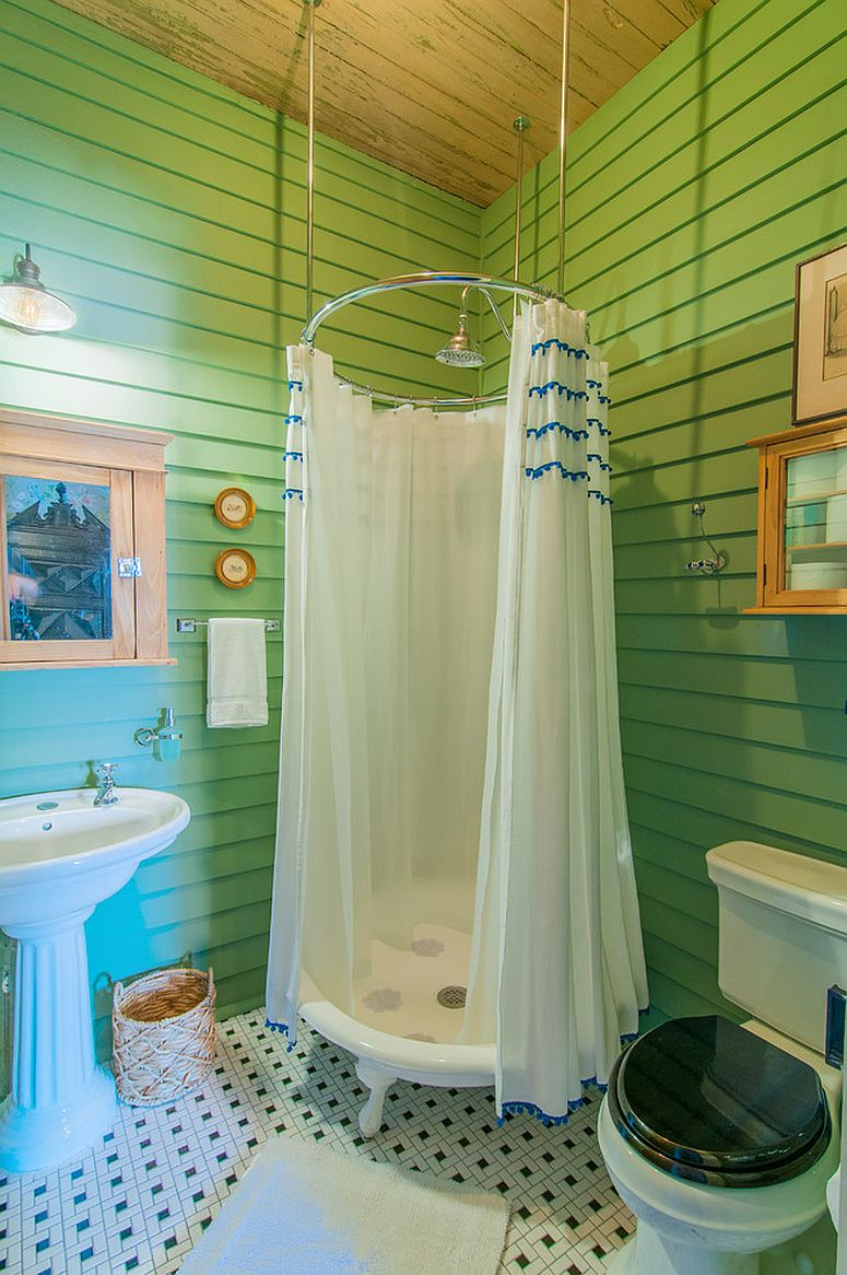 Eclectic bathroom in green with an ingenious shower zone