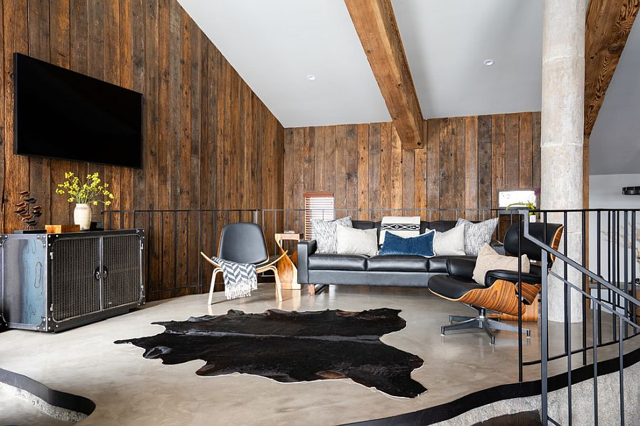 Innovative living room of the house with wooden walls and ceiling beams