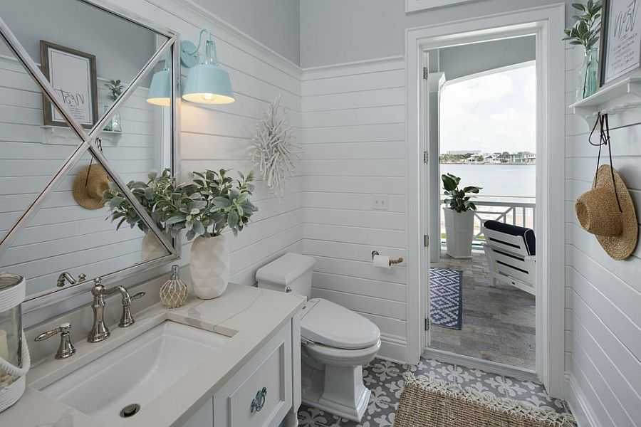 Light-filled and white powder room is connected with the outdoors beautifully