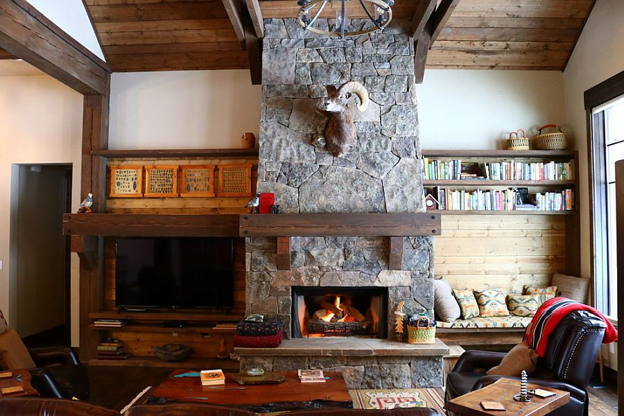 Lovely stone fireplace is a staple in the rustic living room that never fails to impress