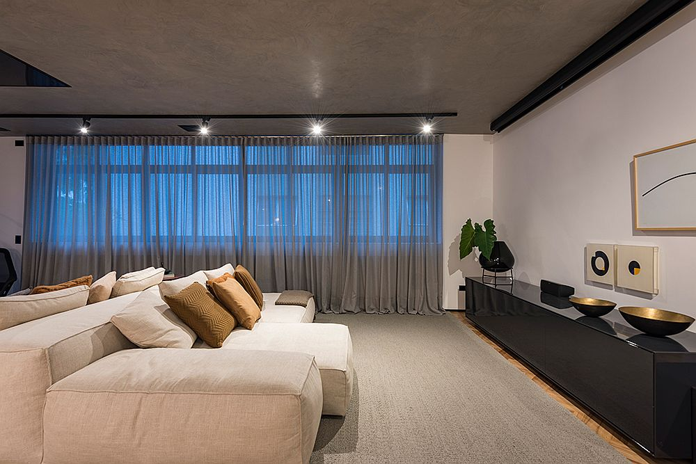 Minimal and stylish bedroom with concrete ceiling and neutral color scheme