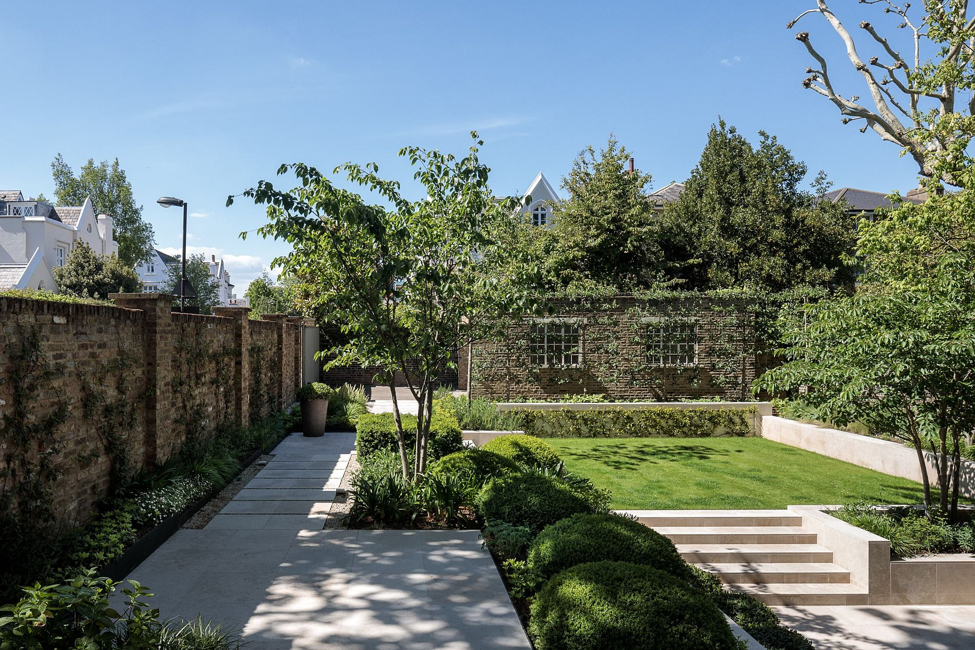 Multi-level gardens with a curated landscape add to the appeal of the house
