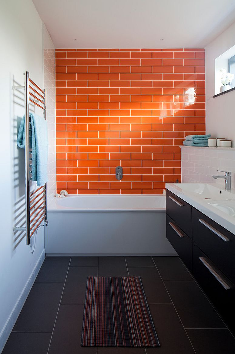 Orange tiled accent wall for the narrow modern bathroom