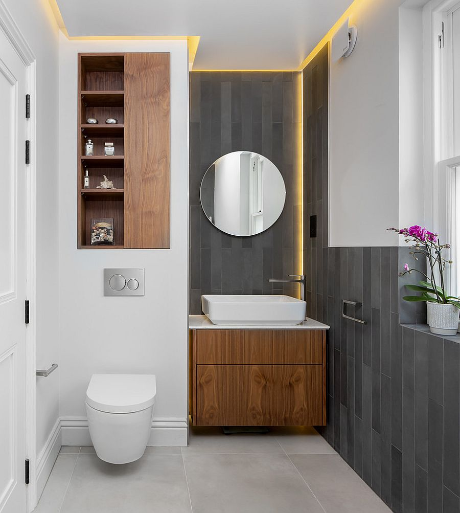 Scandinavian style powder room in gray and white with minimal round mirror