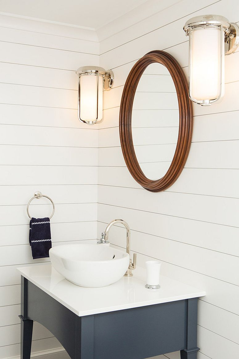 Small coastal themed powder room plays down the beach-inspired elements and looks more modern