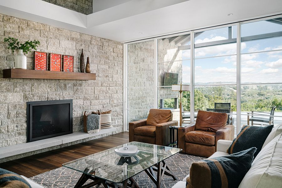 Stone wall for the modern rustic living room in white with glass walls