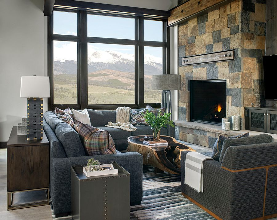 Stunning rustic living room with stone fireplace and a view to match