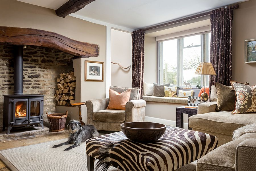 Traditional fireplace is the heart of this beautiful rustic living room