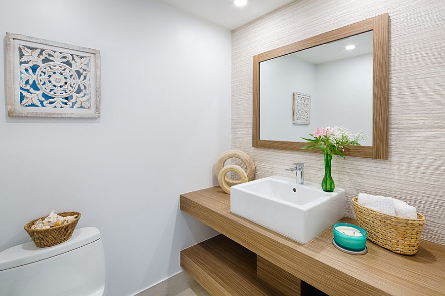 Wood and white powder room of the modern Miami home with coastal flavor