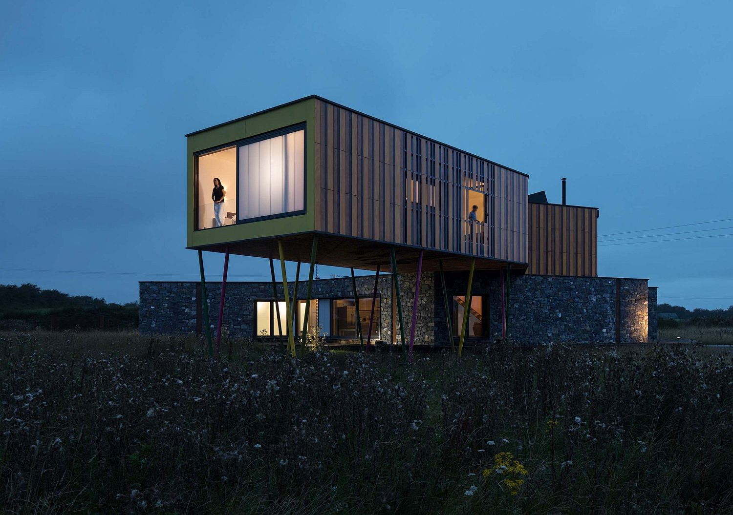 Cantilevered upper level of the house overlooking the meadows in the distance