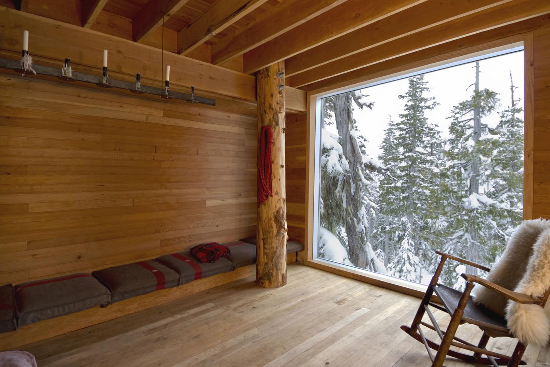 Douglas fir columns, rough sawn fir lumber, and planed fir interior finishes of the cabin