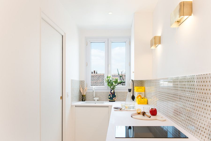 Innovative use of sconce lights in the tiny white kitchen