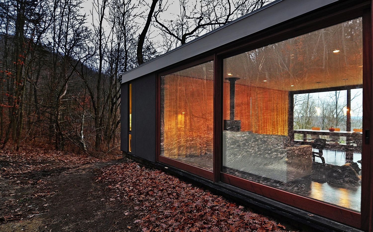 Sliding glass doors connect the interior with the landscape outside
