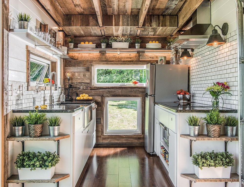 Use of multiple windows to light up the small industrial kitchen with ample woo