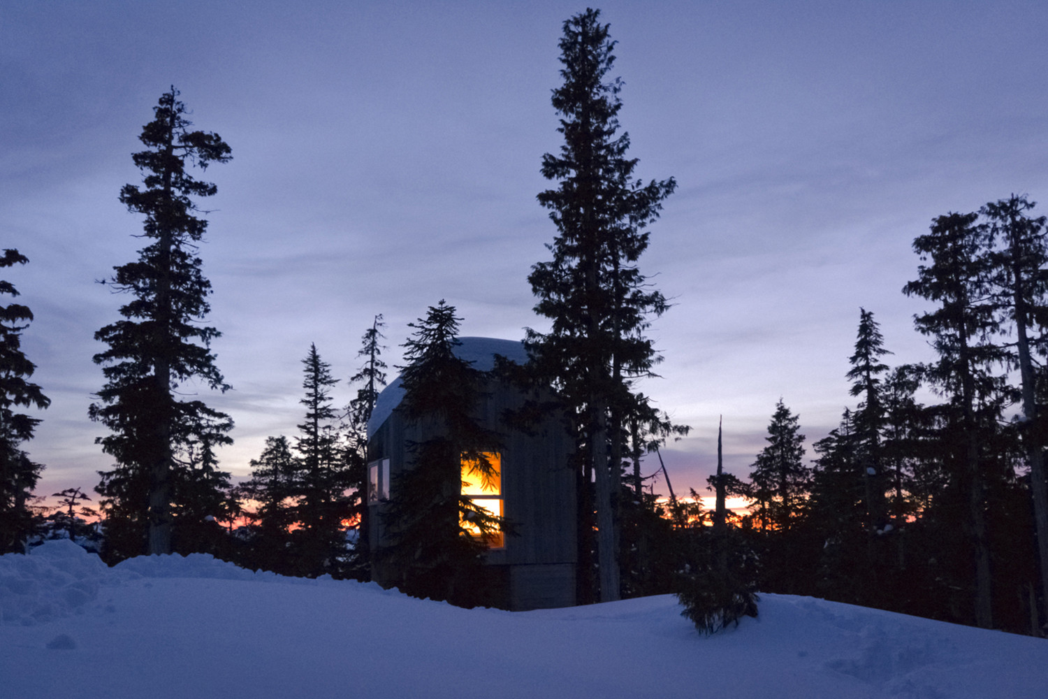 View of the Alpine Cabin after sunset
