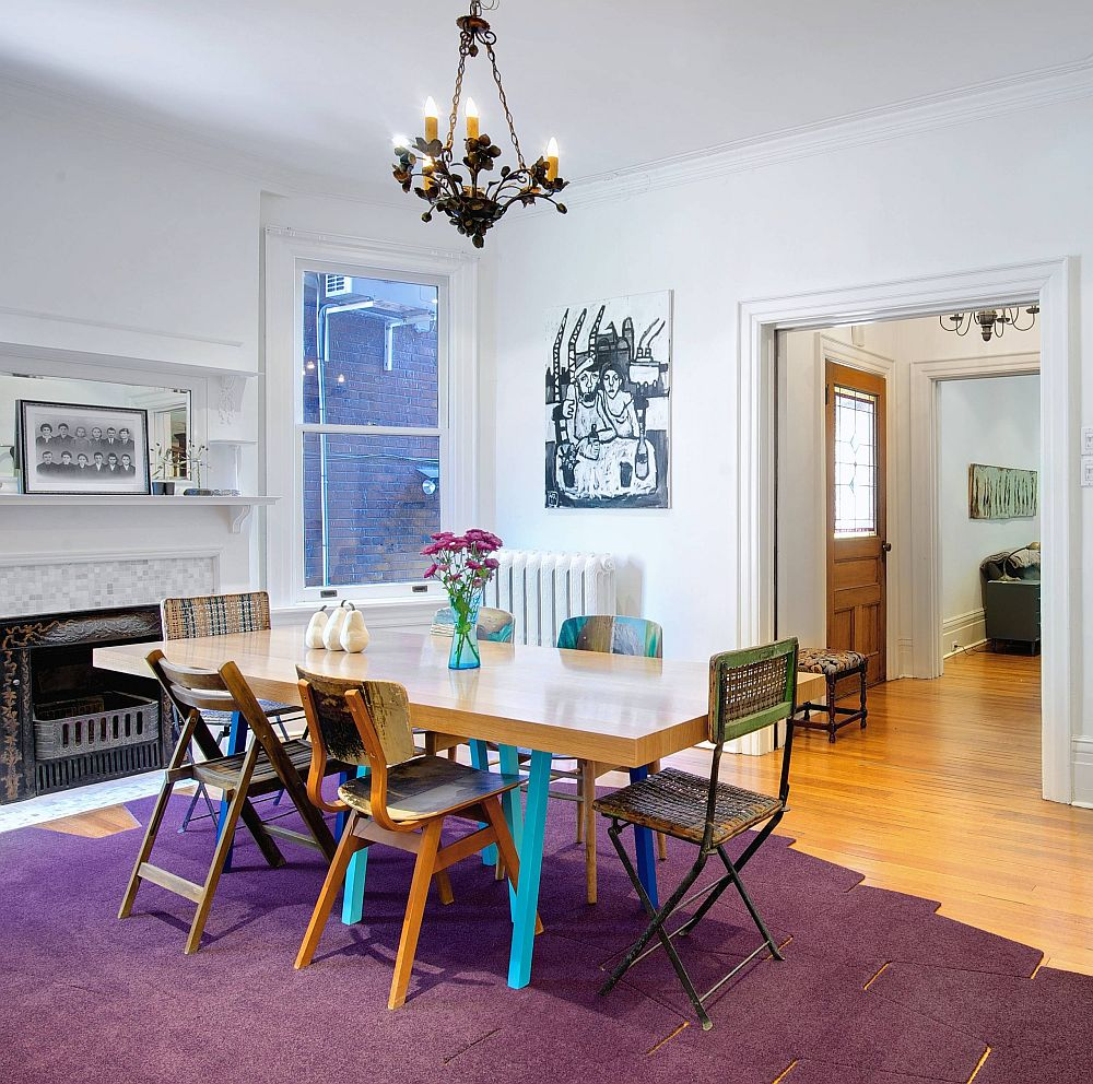 Lovely purple rug adds plenty of brightness to this contemporary dining room in neutral colors
