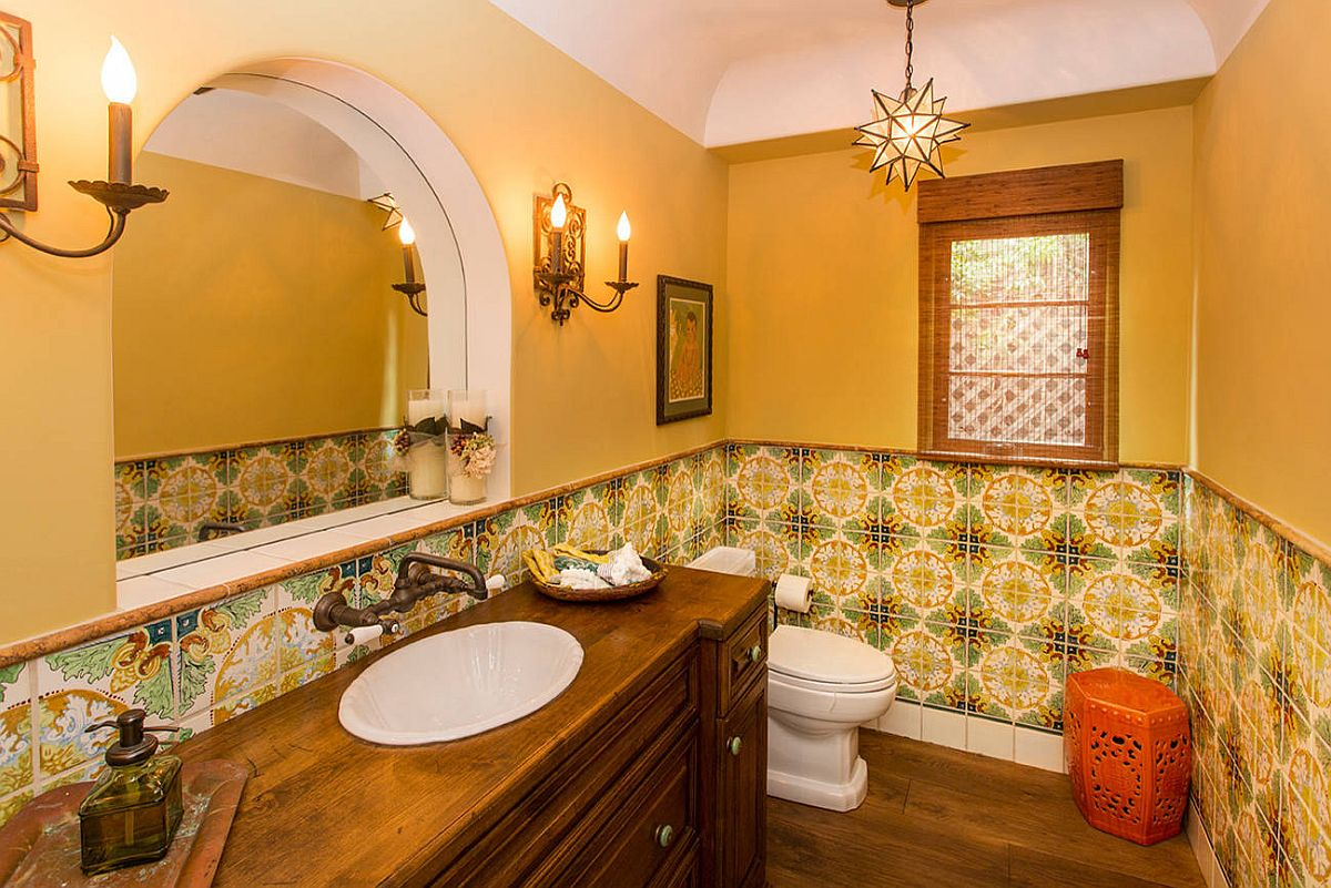 Fabulous Spanish revival style in the powder room with plenty of yellow