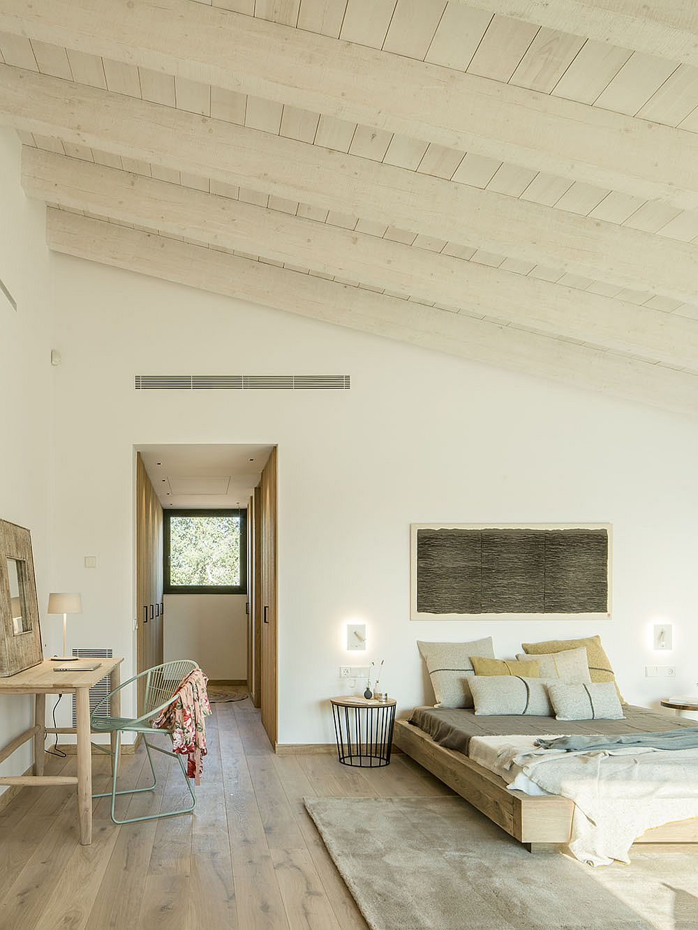 Master bedroom of revamped Spanish house in wood and white