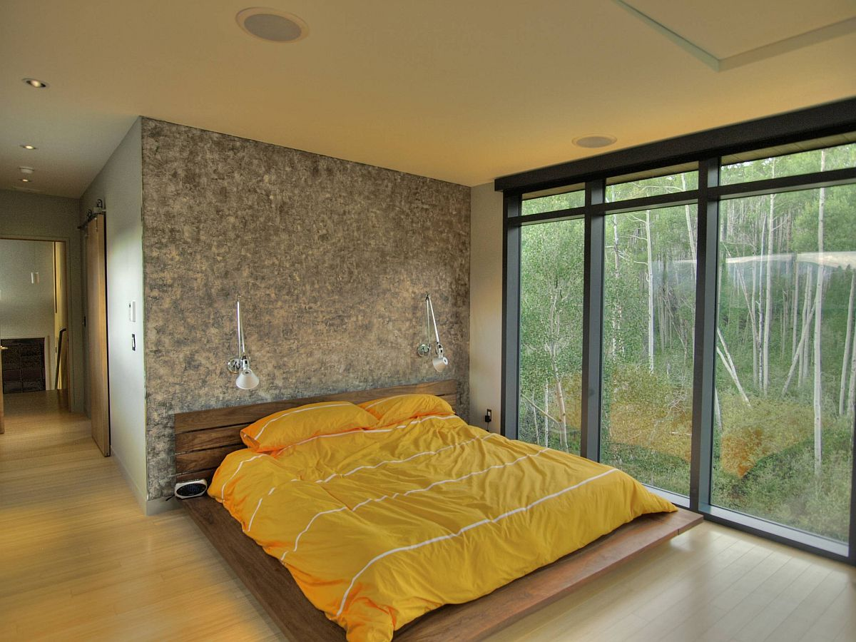 Minimal frame of the platform bed allows other features in the bedroom to shine through
