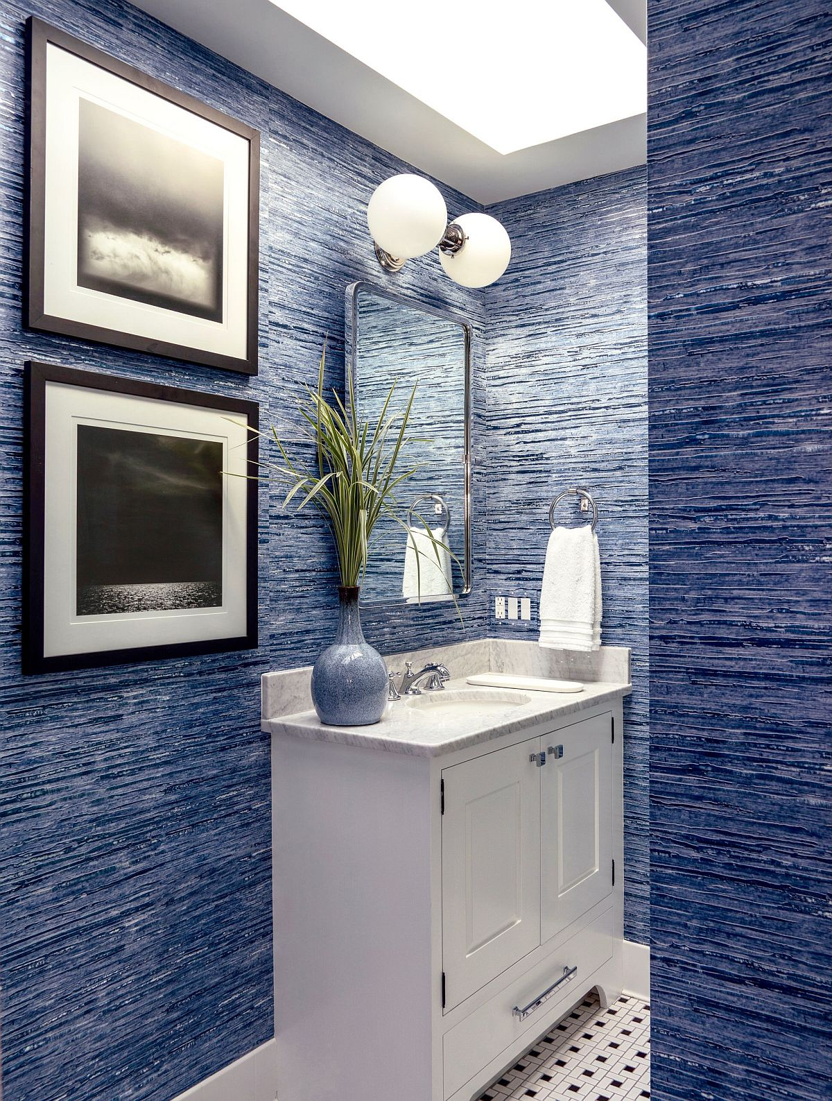 Powder room in blue with textured walls, skylight and flooring with plenty of pattern