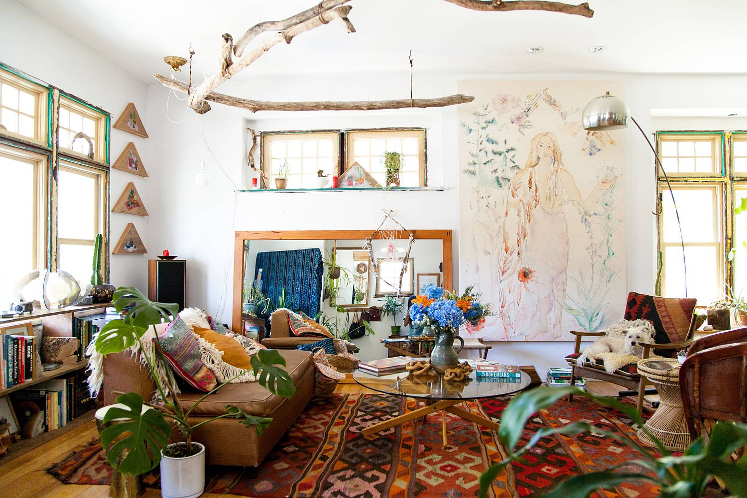 This is a boho chic living room where you find an overload of pattern no matter where you turn!